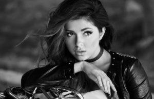 Певица Нюша позирует на фоне мотоцикла, 10 фото
