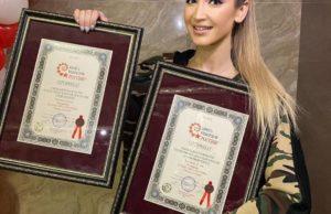 Ольга Бузова получила 2 сертификата от книги рекордов